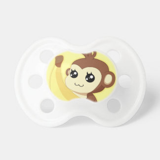 A very cute and kawaii monkey holding a banana dummy