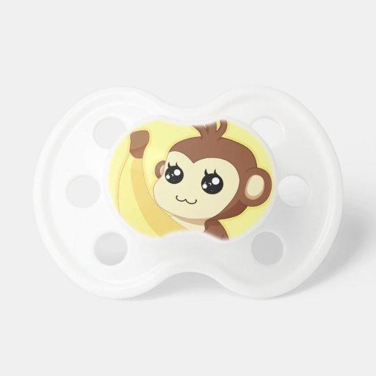 A very cute and kawaii monkey holding a