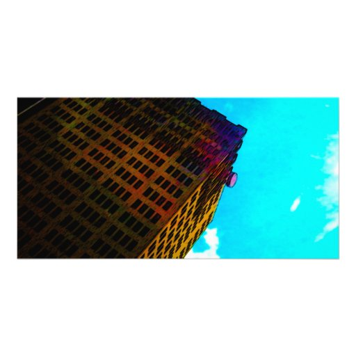 A vibrant and tall building against the  blue sky photo card