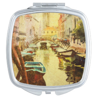 A View Of The Canal With Boats And Buildings Makeup Mirrors