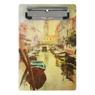 A View Of The Canal With Boats And Buildings Mini Clipboard