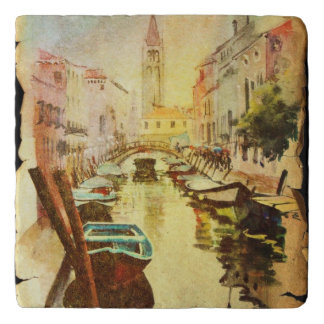 A View Of The Canal With Boats And Buildings Trivet