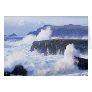 a view of the waves crashing against rocks card