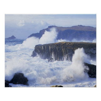 a view of the waves crashing against rocks posters