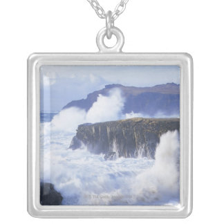 a view of the waves crashing against rocks silver plated necklace