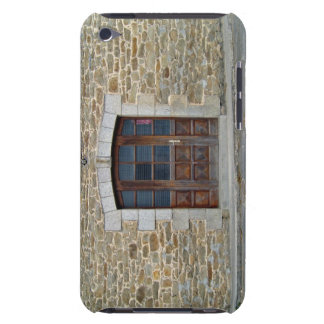 A vintage door and window  in stone wall iPod touch cases
