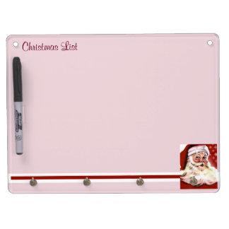 A Vintage Santa Dry Erase Board With Key Ring Holder