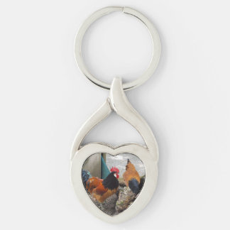 A Vorwerks Chicken pair, Rooster and Hen Eating Silver-Colored Twisted Heart Key Ring