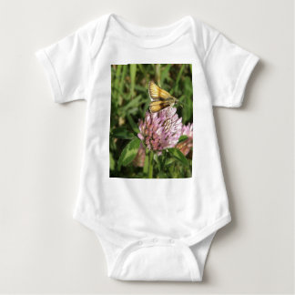 A wee moth on a wee flower baby bodysuit