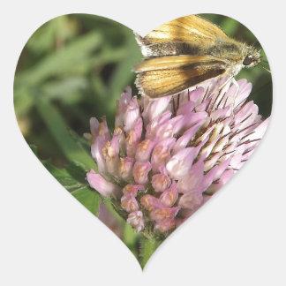 A wee moth on a wee flower heart sticker