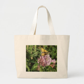 A wee moth on a wee flower large tote bag