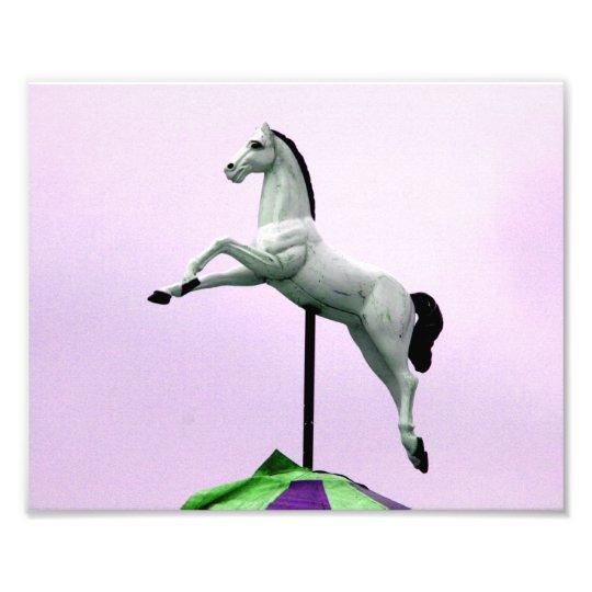 A white horse carousel statue against purple photo print