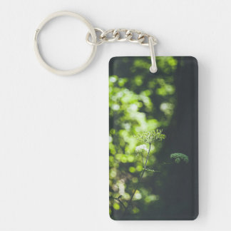 A wild flower in the green nature Double-Sided rectangular acrylic key ring