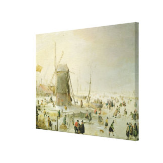 A winter scene with skaters by a windmill canvas print