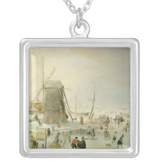 A winter scene with skaters by a windmill silver plated necklace