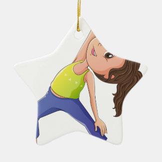A woman doing yoga ceramic star decoration