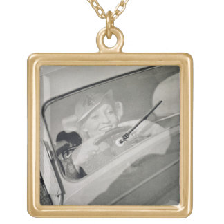 A woman driving, c.1930s (photogravure) gold plated necklace