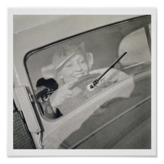 A woman driving, c.1930s (photogravure) poster
