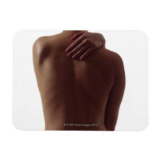 A woman's bare back with one hand reaching rectangular photo magnet