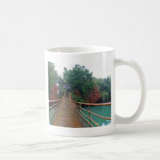 A wooden bridge in a Chinese folk culture park. Coffee Mugs