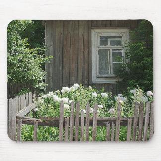 A wooden hut mousepad