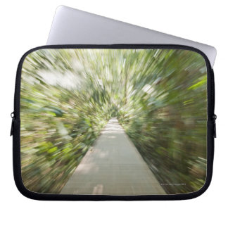 A wooden path through the rainforest in warped laptop sleeve