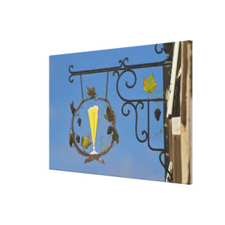A wrought iron sign that illustrates the theme canvas prints