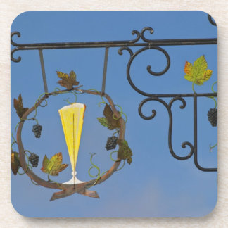 A wrought iron sign that illustrates the theme coaster