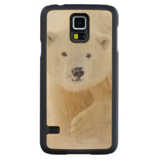 A yearling polar bear cub plays in the snow carved maple galaxy s5 case