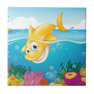 A yellow shark diving into the sea tile