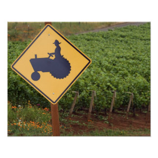A yellow tractor crossing sign in the vineyard poster