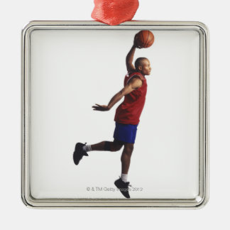 a young adult male basketball player flies christmas ornament