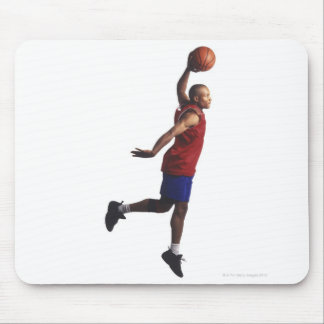 a young adult male basketball player flies mouse mat