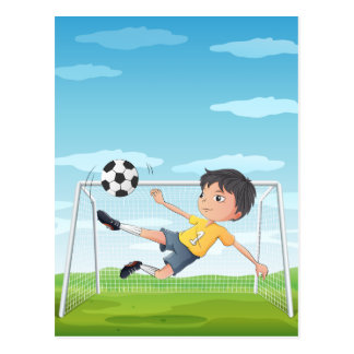 A young athlete kicking the soccer ball postcard