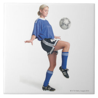 a young blonde caucasian female in a blue soccer large square tile