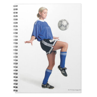a young blonde caucasian female in a blue soccer notebook