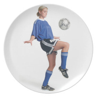 a young blonde caucasian female in a blue soccer party plates