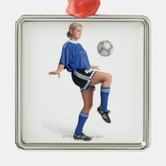 a young blonde caucasian female in a blue soccer Silver-Colored square decoration
