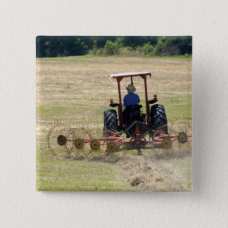 A young boy driving a tractor harvesting 15 cm square badge