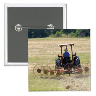 A young boy driving a tractor harvesting pins