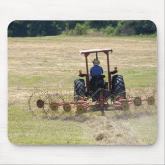 A young boy driving a tractor harvesting mouse mat