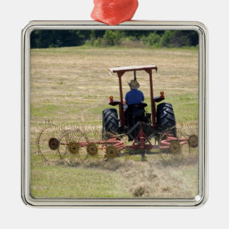 A young boy driving a tractor harvesting Silver-Colored square decoration