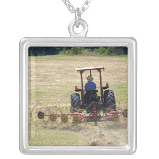A young boy driving a tractor harvesting silver plated necklace