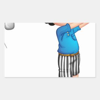 A young boy playing golf rectangular sticker