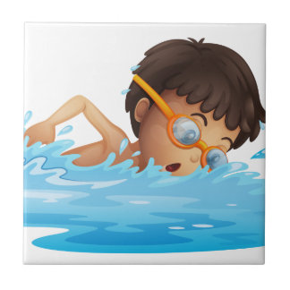 A young boy swimming with a yellow goggles small square tile