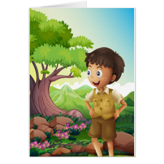A young boyscout in the forest greeting card