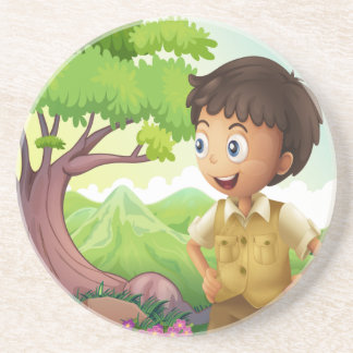 A young boyscout in the forest beverage coaster