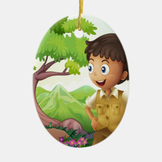 A young boyscout in the forest ceramic oval decoration