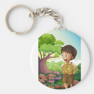 A young boyscout in the forest basic round button key ring