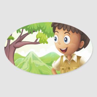 A young boyscout in the forest oval sticker
